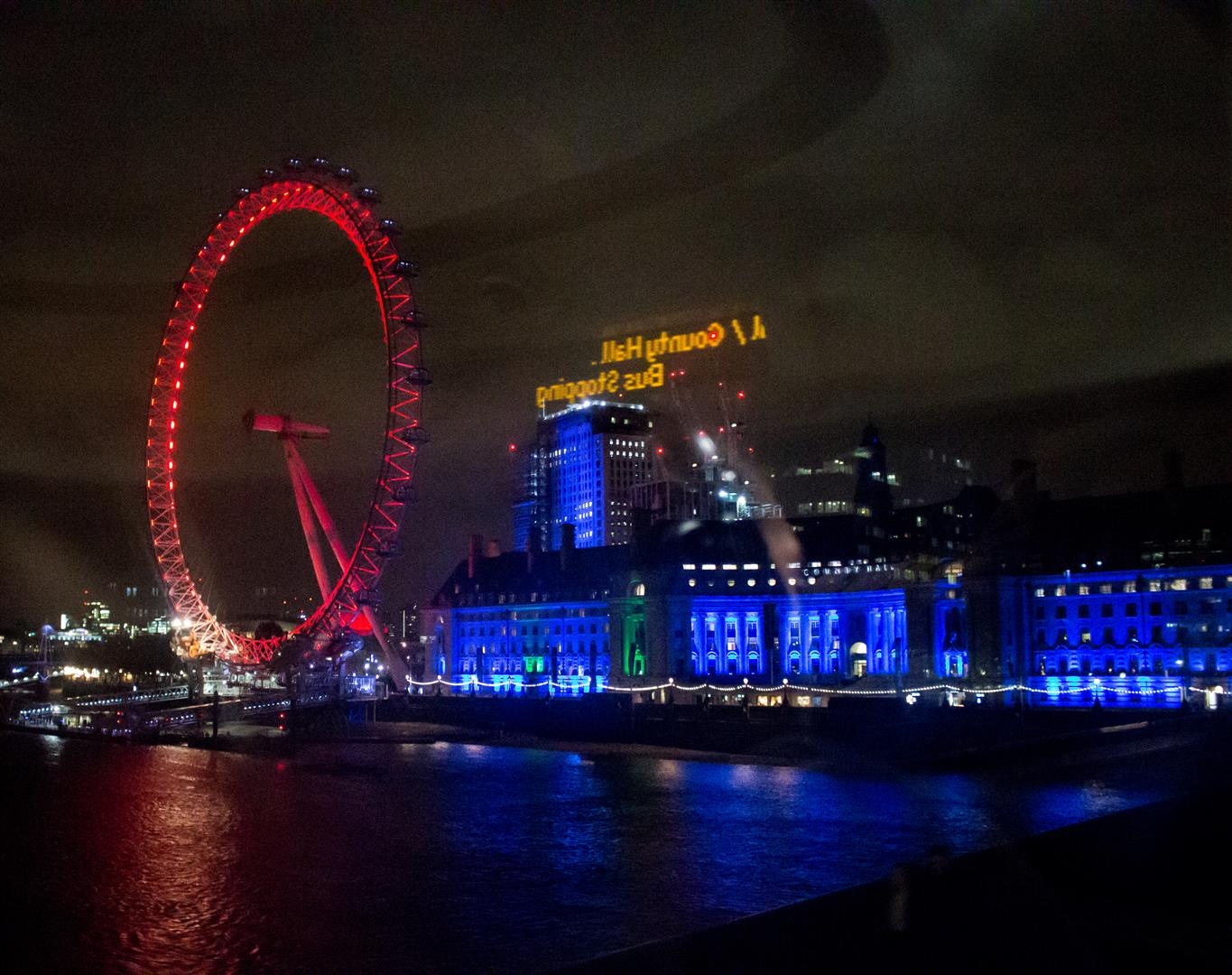 Taken from a big red bus, this place looks awesome at night!