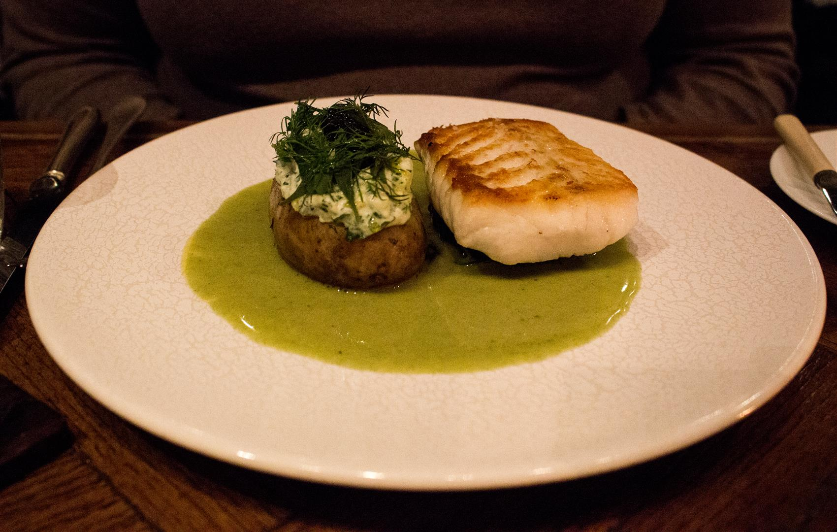 The comforting Hake with Baked Potato